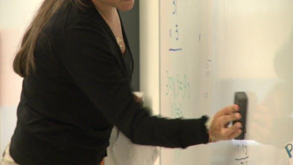 Thumbnail for Teacher Erasing Board In Classroom