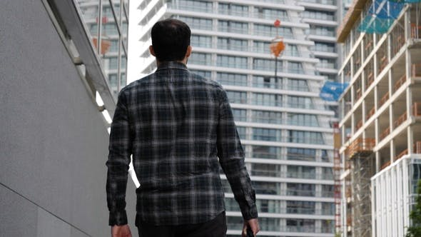Thumbnail for Young Man Walking to The Modern Building.