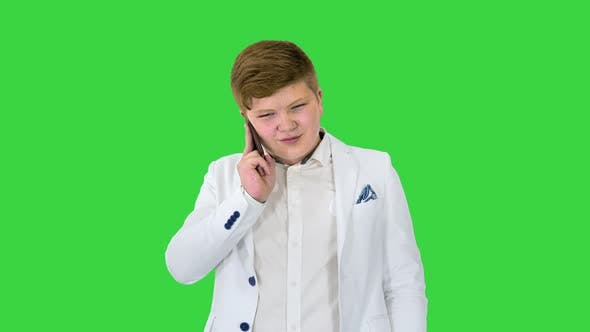 Businessman Boy Making a Call with Smartphone on a Green Screen Chroma Key