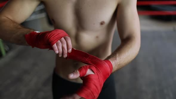 Thumbnail for Man Wrapping Hands Before the Training