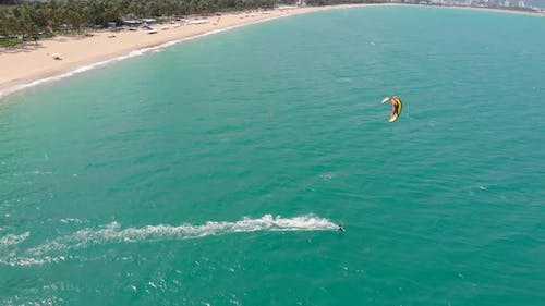 Acrobatic Jump of Professional Kite Surfer on the Sea Wave, Athlete Showing Sport Trick Jumping