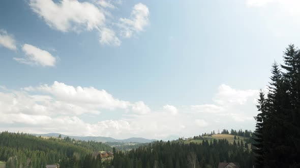 Time lapse of beautiful mountain landscape with cloudy blue sky