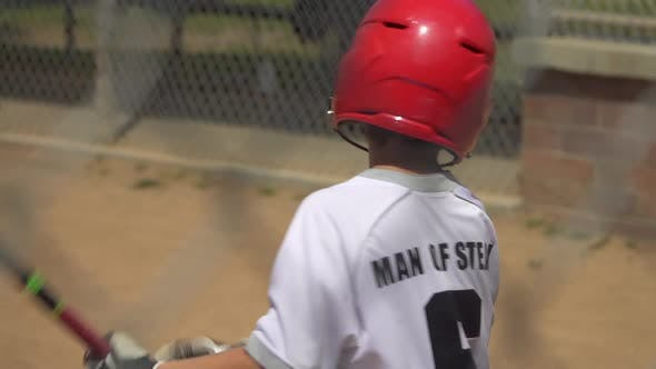 Thumbnail for Boy at bat and batting in a little league baseball game.