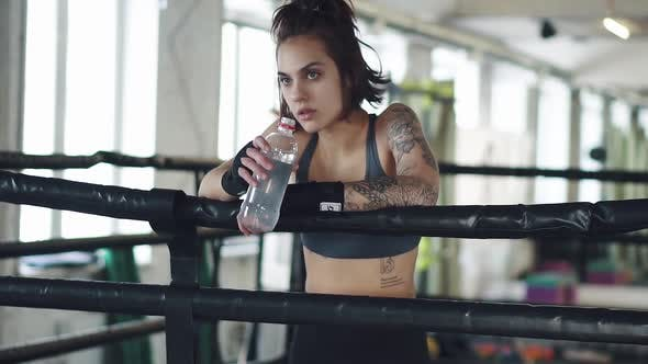 Thumbnail for Girl Drinks Water in the Gym