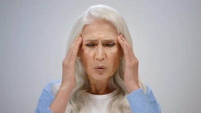 Stressed Woman Having Headache Indoor
