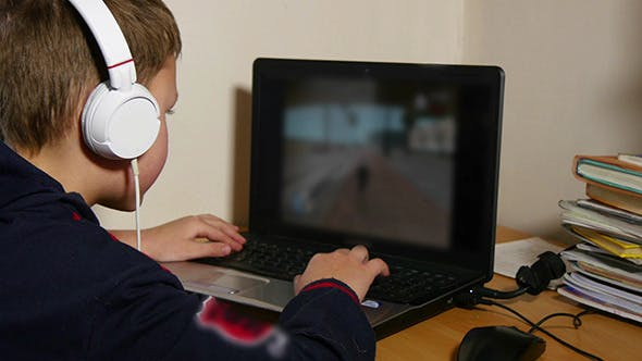 Thumbnail for Young Boy Playing Video Games