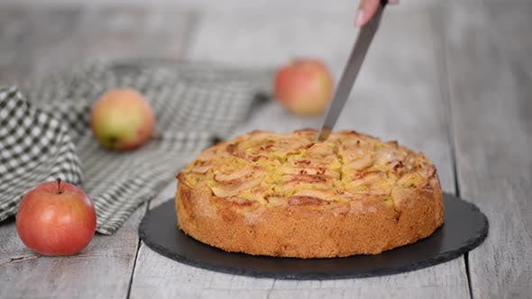 Thumbnail for Cutting a Piece of Delicious Apple Cake with a Knife