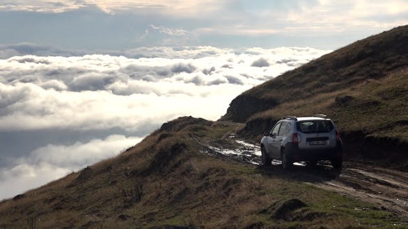 Thumbnail for Car Going on Mountain Pass Above the Clouds