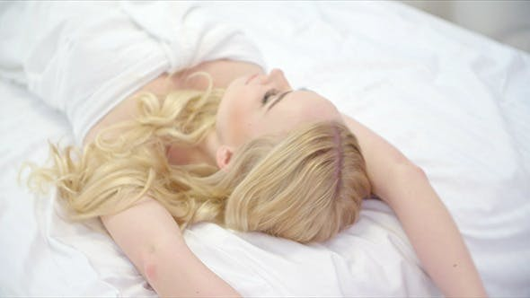 Thumbnail for Beautiful Blond Girl Lying on Bed