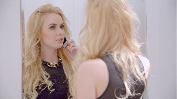 Thumbnail for Cute Blond Sexy Girl Talking Cell Phone