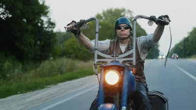 Biker in Sunglasses Riding Chopper and Countryside