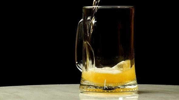 Cover Image for Beer is Poured into a Glass