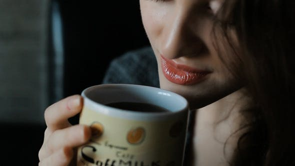 Thumbnail for Woman In Drinking Coffee