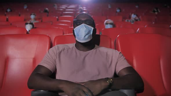 Portrait of Masked African American Man in Cinema