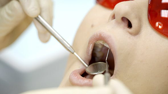 Thumbnail for Woman Being Under Dentists Examination