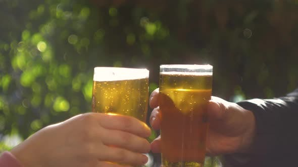 Celebration Beer Cheers Concept Close Up Hands Holding Up Glasses of Beer of People Group in Outdoor