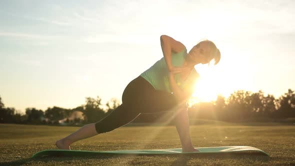 Thumbnail for Adult Healthy Woman Practicing Yoga at Sunset