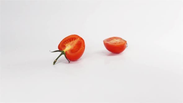 Thumbnail for Two Halves of Tomato Breaks Hitting White Surface
