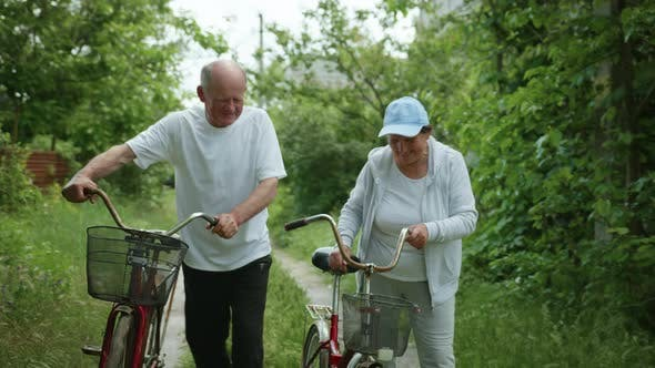 Thumbnail for Happy Retirement Couple Leads an Active Lifestyle Enjoy a Bike Ride