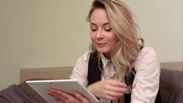 Thumbnail for Excited Smiling Woman Having Video Call on Tablet While Sitting on Her Bed