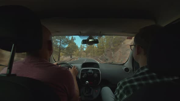Thumbnail for A View of a Mountain Road From a Backseat of a Moving Car