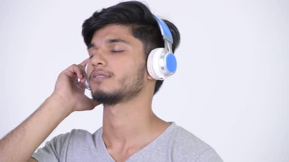 Thumbnail for Young Happy Bearded Indian Man Listening To Music