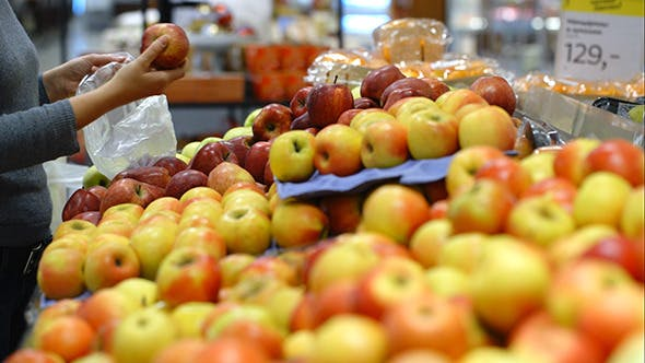 Thumbnail for Putting Apples In Plastic Bag In Supermarket