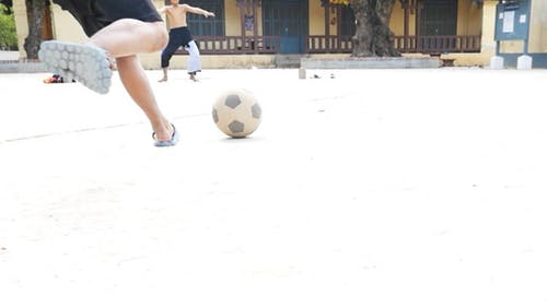 Kid Running and Shooting A Ball