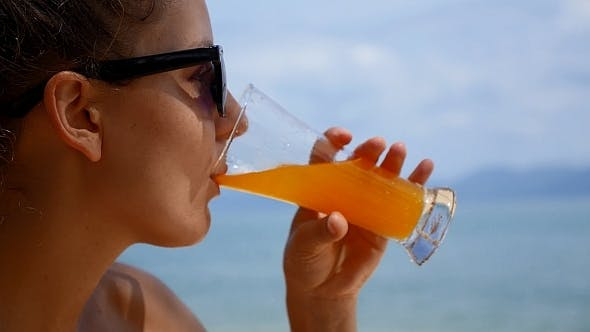 Thumbnail for Woman Drinking Juice against Sea