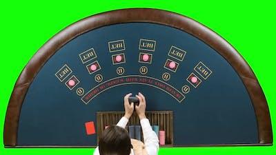 Casino Dealer Woman Shuffles the Poker Cards. Green Screen