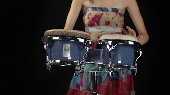 Thumbnail for Female Percussion Drummer Performing With Bongos 3