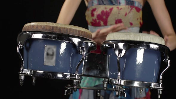 Thumbnail for Female Percussion Drummer Performing With Bongos 4