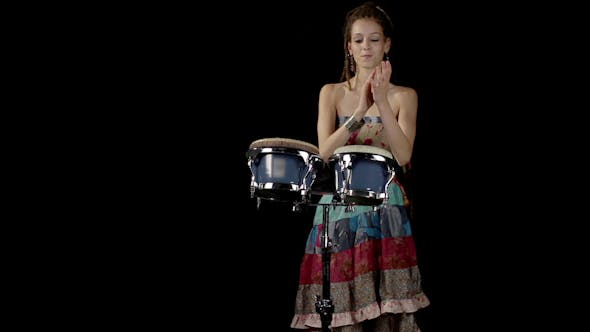 Thumbnail for Female Percussion Drummer Performing With Bongos 7