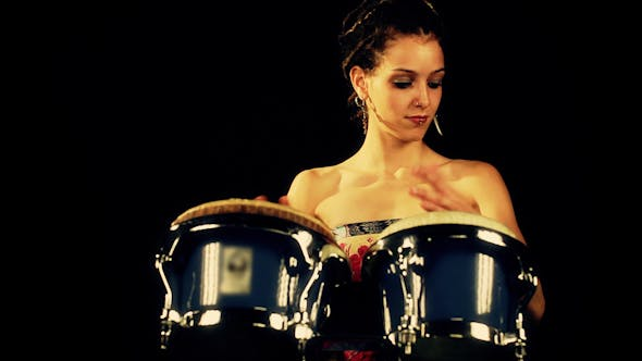 Thumbnail for Female Percussion Drummer Performing With Bongos 9