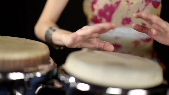 Thumbnail for Female Percussion Drummer Performing With Bongos 13