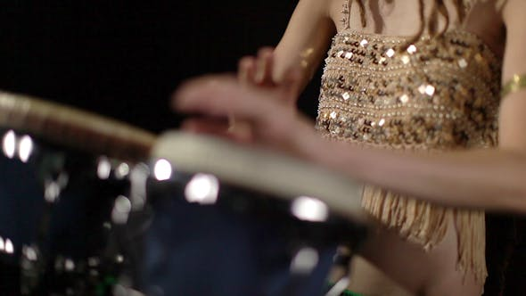 Thumbnail for Female Percussion Drummer Performing With Bongos 21