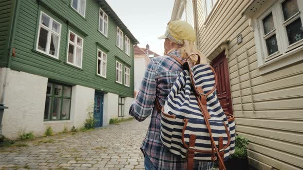 Thumbnail for Tourist with a Map in Her Hands Walking Through the Narrow Streets of Bergen in Norway