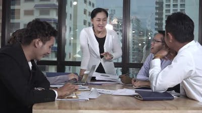 Asian Business People Discuss Marketing Strategy