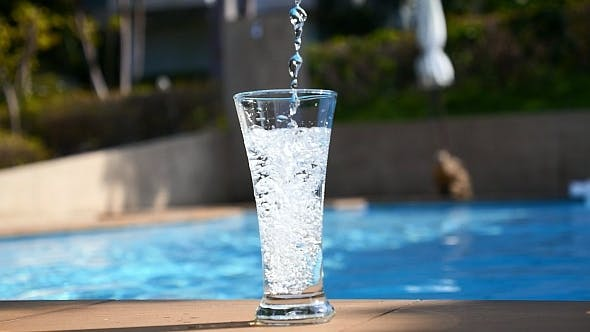 Thumbnail for Pouring Water in Glass near Pool
