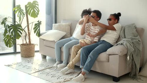 Cute Children in 3d Glasses Watching Movie on Couch