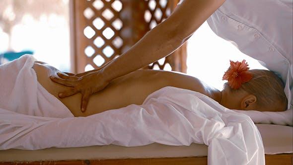 Woman Getting Body Massage At Beauty Spa