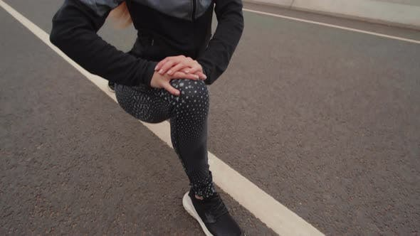 Thumbnail for Female Runner Stretching before Run