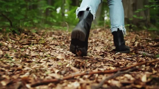 Thumbnail for Backview of Female Hiking Boots in Forest