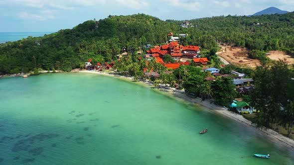 Beautiful birds eye island view of a sandy white paradise beach and blue water background in colourf