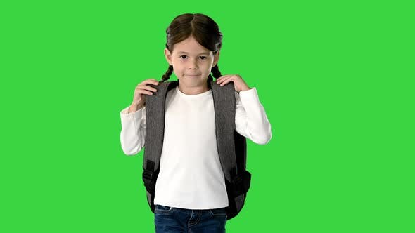 Thumbnail for Smiling Little Girl Walking To School Holding Her Backpack and Looking at Camera on a Green Screen