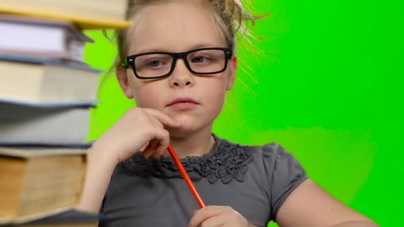 Cover Image for Girl Leafing Through a Book of Interesting Looks for Another. Green Screen. Close Up