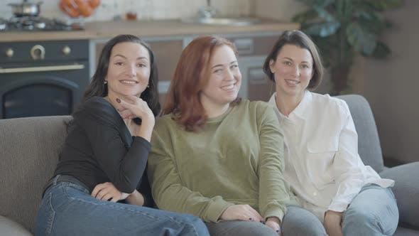 Thumbnail for Three Smiling Beautiful Women Waving at Camera and Talking
