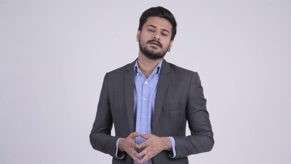 Thumbnail for Young Handsome Bearded Indian Businessman Explaining Something