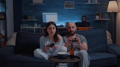 Focused Determined Couple Playing Video Game Late Night