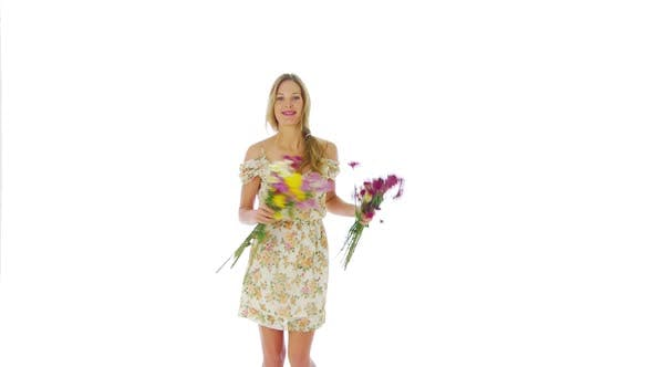 Thumbnail for Woman throwing flowers into the air
